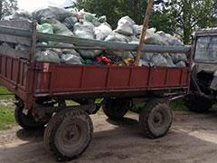 трактор с мусором тко